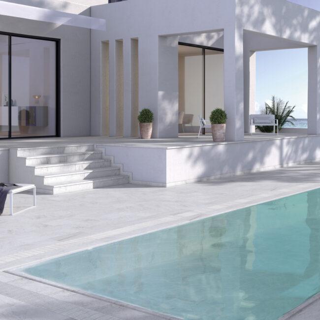 white stone piscina desbordante gresmanc